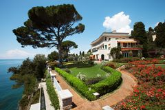 Villa park overlooking sea, summer day royalty free stock images