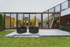 Villa patio with rattan chairs Stock Images