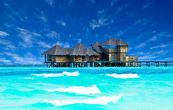 Villa on piles on beautiful beach. Stock Photography