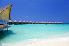 Villa on piles on water Maldives. Royalty Free Stock Images