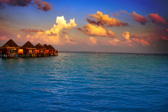 Villa on piles on water at the time sunset Royalty Free Stock Image