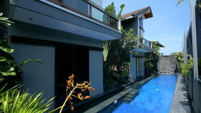 Villa and pool. Beautiful villa with swimming pool in Bali stock footage