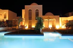 Villa and Pool in the Evening Royalty Free Stock Images