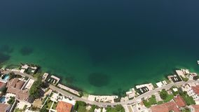 Villa with pool in the village of Ljuta. Montenegro, Bay of Koto. R. Shooting from the air, aerial photography drone stock video footage