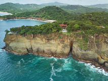 Villa on rock cliff. In NIcaragua aerialdrone view. Rental luxury houses service Royalty Free Stock Photo