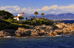 Villa on the Rocky Mediterranean coastline Stock Photos