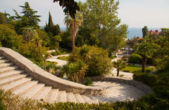 Villa stairs. Beautiful villa in ancient greek classic style with landscaped green territory; outdoor panorama with copy space stock photography