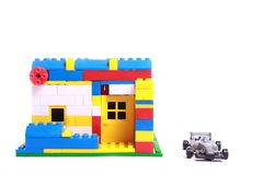 Villa structure made by building block with car. Using small small colorful a small villa house is built and photographed with super toy car against while Stock Image