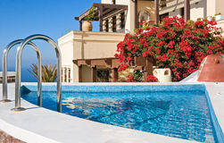 Villa with swimming pool. Greek villa with swimming pool, Santorini Stock Photos
