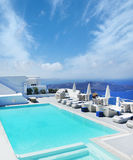 Villa with swimming pool on the hill on Santorini island Royalty Free Stock Photos