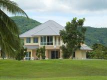 Villa in tropical setting Royalty Free Stock Photos