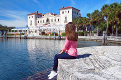 Villa Vizcaya Museum tourism. Miami, United States - February 8, 2016: Tourist girl look at the Villa Vizcaya of Biscayne Bay in Miami stock images