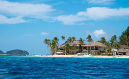 Villa on white sand tropical beach Stock Photos