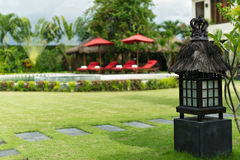 Villa yard with garden lamp. Villa yard with traditional Balinese garden lamp Stock Photography