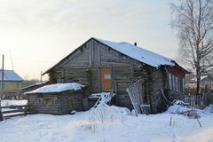 The Village Of Abramovskaya Lower Maloshuyka, Vachevskaya. Old wooden house in winter. Arkhangelsk region, Russia stock images