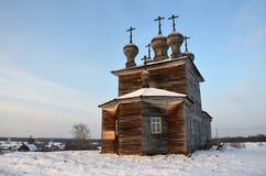The village of Abramovskaya Lower Maloshuyka, Vachevskaya. Sretenskaya Church in winter morning, 1873. Russia, Arkhangelsk regio royalty free stock photos