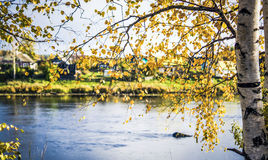 The village across the river in autumn Stock Photo