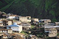 Village against dark mountain Stock Photography