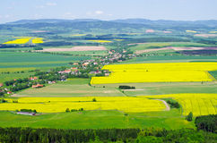 Village in the agricultural terrain Stock Images