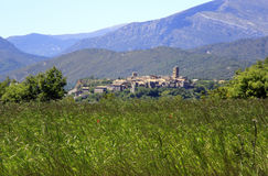 Village of ainsa, pyrenees. Village of ainsa in sunny day,  trees,  , ara valley, pyrenees, near ainsa, mountain and green grass, houses, blue sky Royalty Free Stock Photos