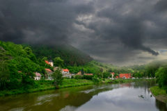 Village along the river. View on river and green hills of Karlstejn village near Prague, Czech Republic Stock Images
