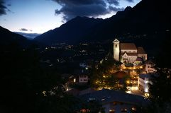 Village in Alps. Village in the evening in the Alps royalty free stock photos