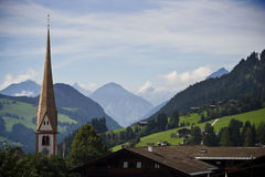 Village in the Alps. View of a small austrian village in the Alps, with a church belltower Royalty Free Stock Photography