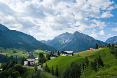 Village in the Alps. A small village in the austrian alps at the Kleinwalsertal Royalty Free Stock Images