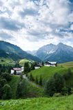Village in the Alps. A small village in the austrian alps at the Kleinwalsertal Royalty Free Stock Photography