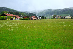 Village In Alps. Small village with meadows under Austria Alps,forest as background,Austria.Europe Stock Image