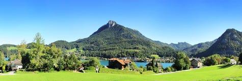 Village in Alps. Village near the lake in the Alps mountains. Austria Stock Photos