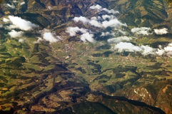 Village in The Alps. Seen from aeroplane window. Picture taken in autumn time stock images