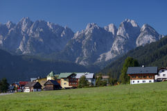 Village in alps with mountain ridge in background. Gosau village seen in morning light with dachstein mountain ridge in background Royalty Free Stock Images