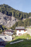 Village in the Alps mountains. Of France with trees of the mountains in a sunny day. It´s a vertical picture Stock Photography
