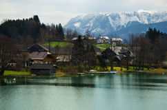 Village with Alps range and lake background Stock Images