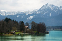 Village with Alps range and lake background Royalty Free Stock Image