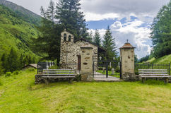 The village in the Alps. A small village cemetery. Lombardy, Adamello, Region Brescia Stock Image