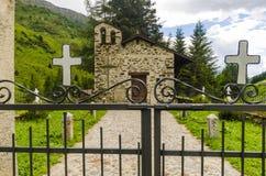 The village in the Alps. A small village cemetery. Lombardy, Adamello, Region Brescia Stock Photos