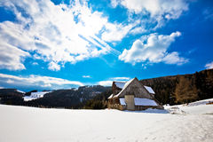 Village in Alps under deep snow Stock Photos