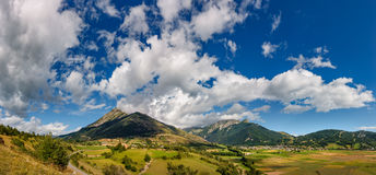 Village of Ancelle and the Autane mountain peaks in Summer. Hautes Alpes, France. Panoramic summer view on the village of Ancelle and the Autane mountain peaks Royalty Free Stock Photos