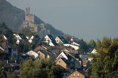 Village with a Ancient Castle. Village and a Historic Castle in the Background, Germany stock images