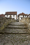 Village with ancient stone bridge. Beautiful spanish village in Navarra during the autumn Royalty Free Stock Images