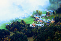Village Appearing from Fog in the Morning Royalty Free Stock Photography