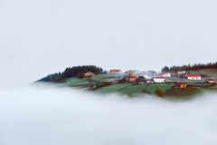 Village in Aramaio valley surrounding by fog. Village and houses in Aramaio valley surrounding by fog Royalty Free Stock Photography