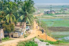 Village in Assam India near rice fields royalty free stock photography