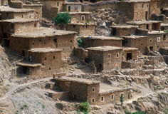 Village in the Atlas Mountains. Traditional dwellings in a valley of the Atlas mountains in Morocco royalty free stock image