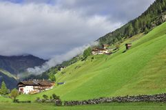 Village in Austria with green lawns and mountains Stock Photos