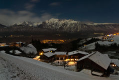 Village at the Austrian Alps. Traditional village at the Austrian Alps under the moonlight in winter Royalty Free Stock Image