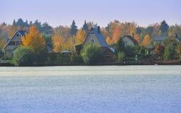 Village in autumn lake Royalty Free Stock Photos