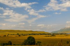Village in the background of the rocky mountains Stock Photography